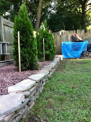 Flagstone Wall with New Arbs